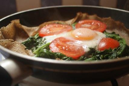 Homemade spinach, tomato, egg crepe.