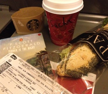The right way to travel: a good book, your tickets (can't forget those), a chai with your name spelled à la française, and a sandwich from Paul.