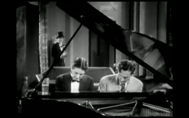playing piano with the butler, beer on the left, fried chicken on the right.