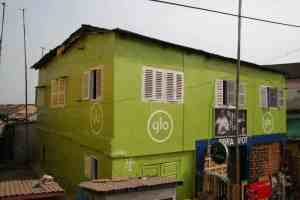 Glo advertising on a house, Elmina, Ghana (2011-12)