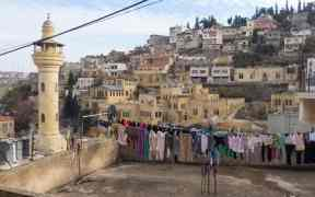 Colorful Laundry drying over the yellow city of As-Salt, Jordan (2016-12-21)