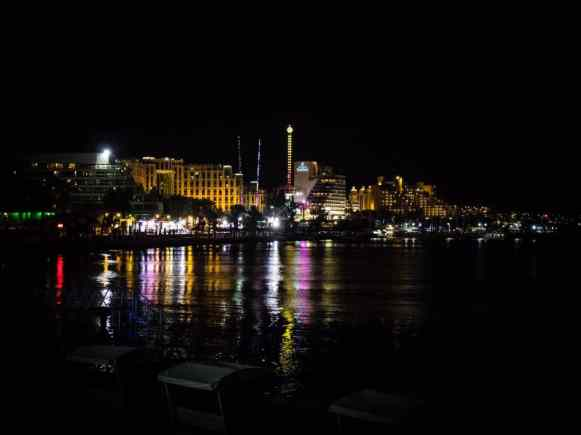 Lights of the fairground on the promenade in Eilat at night, Israel (2016-12-30)