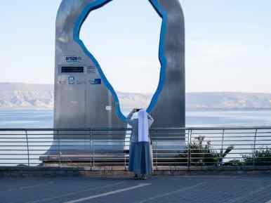 Nun taking a picture, Tiberias, Sea of Galilee, Israel (2017-01-23)