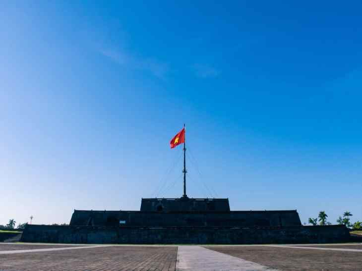 The Vietnamese flag over Hue Citadel, Vietnam (2017-06)
