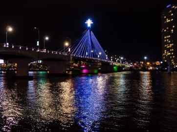Lights on the bridge at night by the river, Da Nang, Vietnam (2017-06)