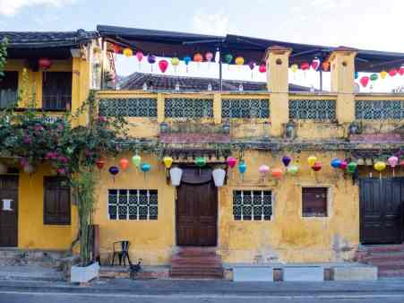 Typical yellow house with lanterns in Hoi An, Vietnam (2017-05/06)