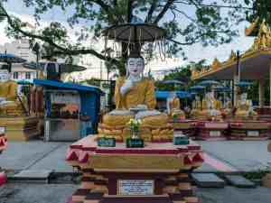 Hand signs at the Skinny Buddha, Mandalay, Myanmar (2017-09)