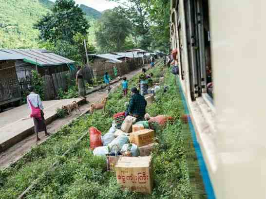 Myanmar train travels: People getting off the slow train Shwenyaung (Inle Lake) to Thazi, Myanmar (2017-10)