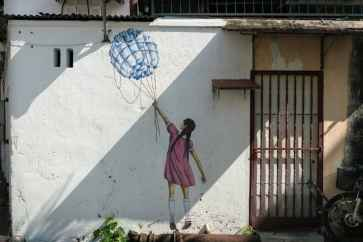 Penang Street Art: Girl with bottle balloon - George Town, Malaysia - 20171218-DSC02911