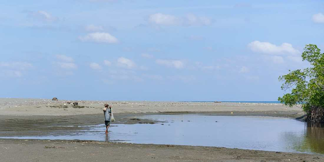 Fisherman at the beach, Suai, East Timor