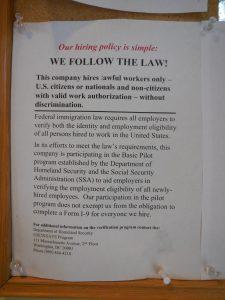 We Follow The Law E-Verify poster