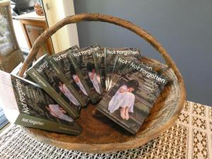 Basket of the book Not Forgotten: they called me Number 10 at Neerkol Orphanage