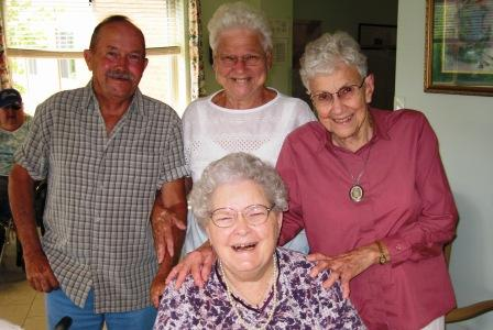 """Erma Moser's """"Don't Forget Us""""  gave us our name."""