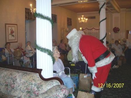 Christmas Party Rose Manor. Santa gives out home made lap quilts.