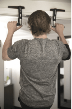 man doing pullups on crossgrips