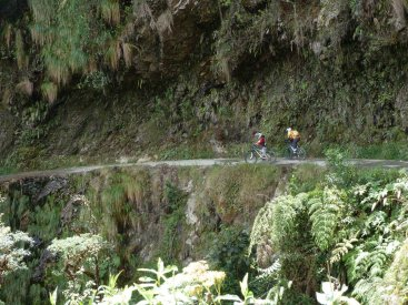 Death Road Bolivia cycling under a waterfall