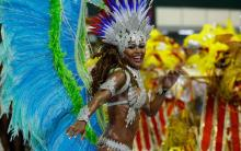 A reveller dances on a float of the Inocentes de Belford Roxo samba school on the first night of the annual carnival parade in Rio de Janeiro's Sambadrome