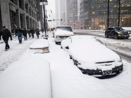 Cars are covered with snow along Wacker Dr. in Chicago, Monday, Jan. 28, 2019. (Rich Hein/Chicago Sun-Times via AP)