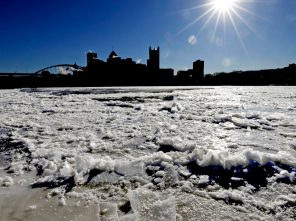 The sunrises over downtown Pittsburgh and a partially frozen Allegheny River on Thursday, Jan 31, 2019. The temperature in Pittsburgh dropped to minus 4 late Wednesday, breaking an 85-year-old record low for Jan. 30 of minus 1 degree. (AP Photo/Gene J. Puskar)