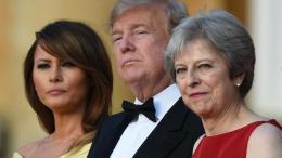 Melania Trump, Donald Trump y Theresa May, este jueves en la cena de gala.