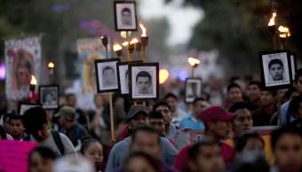 Manifestación por las desapariciones de Ayotzinapa. (AP Photo/Marco Ugarte, File)