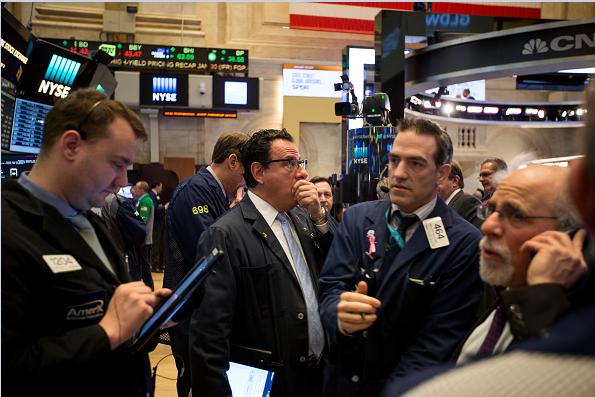 Corredores de bolsa en Wall Street.