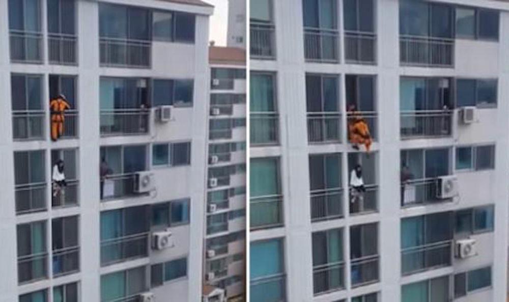 Acrobática maniobra de bombero para salvar a una joven del suicidio