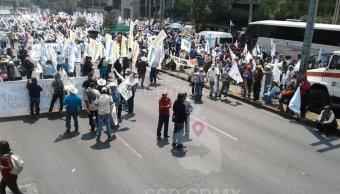 Manifestantes bloquean avenida Constituyentes, en CDMX . (Twitter/@OVIALCDMX)