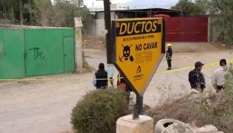 Letrero de Pemex que advierte sobre ductos de combustible y pide no cavar (Noticieros Televisa)