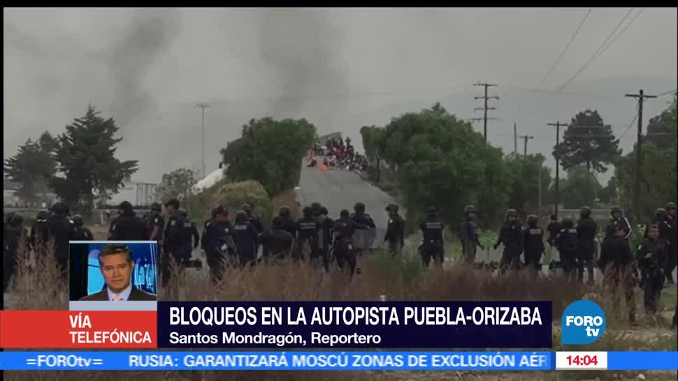 noticias, televisa news, Manifestantes, Puebla-Orizaba, salida de militares, bloquean autopista