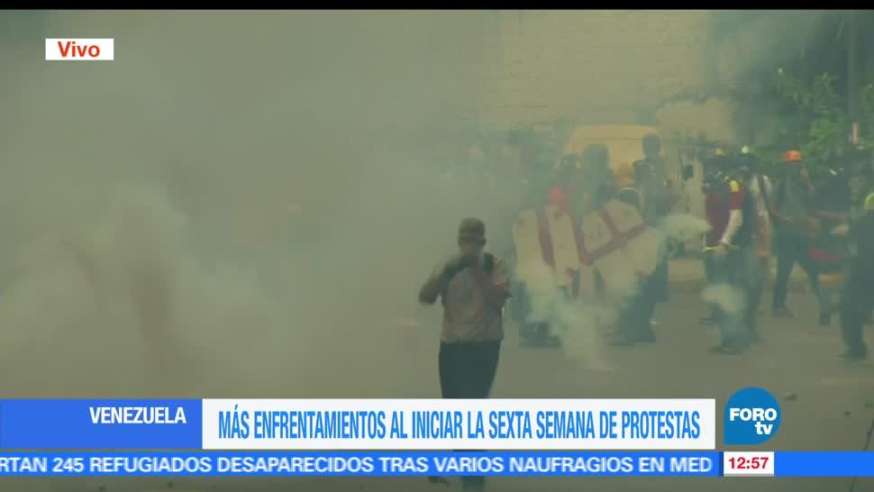 Guardia Nacional Bolivariana, manifestantes opositores, Caracas, Venezuela, enfrentamientos