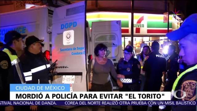 conductora muerde, policía, detenida, Torito, CDMX