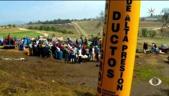 noticias, televisa news, Ninos, jovenes y mujeres, roban combustible, Puebla