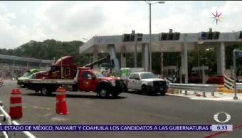 camión de carga, dos autos, caseta, Lerma Marquesa
