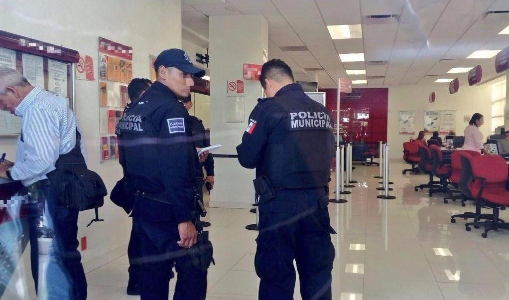 Asalto, robo, banco, dinero, encapuchados, policia