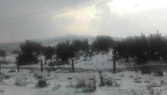 Se reporta una fuerte granizada en Zempoala, Hidalgo. (Twitter @E_PadillaH)