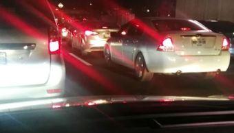 vehiculos detenidos en la autopista por accidente