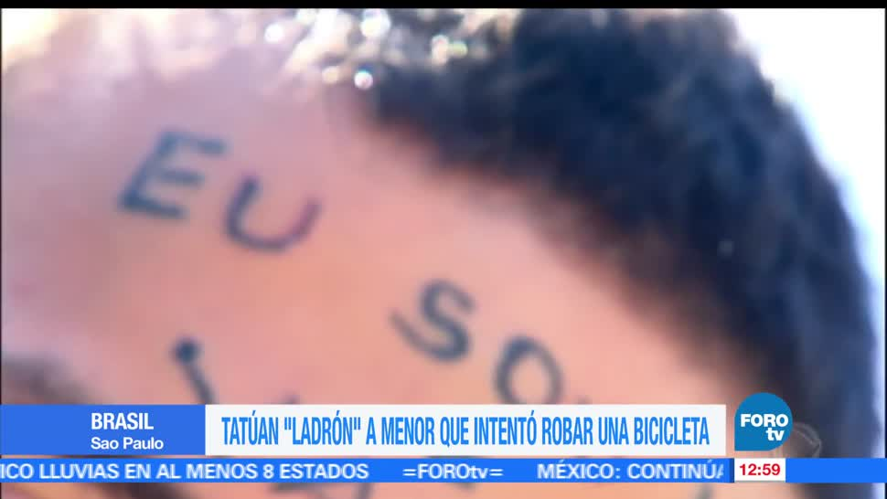 joven tatuado, frente, frase Soy ladrón, Sao Paulo, Brasil