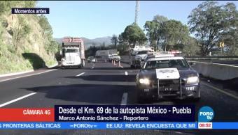 camioneta, cajas con chocolates, barrera de contención, autopista México-Puebla