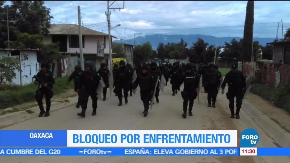 Manifestantes, bloquean la carretera 175, colonia González Guardado, Oaxaca, enfrentamiento