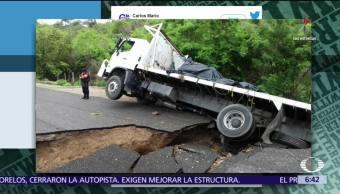 noticias, televisa, DenunciaEnDespierta, Socavón, traga camión, carretera Pinotepa-Oaxaca