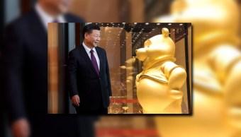 El presidente de China Xi Jinping y una figura de Winnie the Pooh (Getty Images)