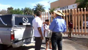Familiares de policías emboscados en Guerrero piden indemnización