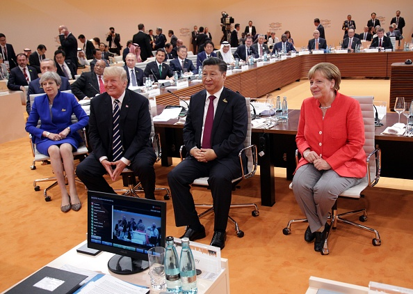 Theresa May, Donald Trump, Xi Jinping y Angela Merkel
