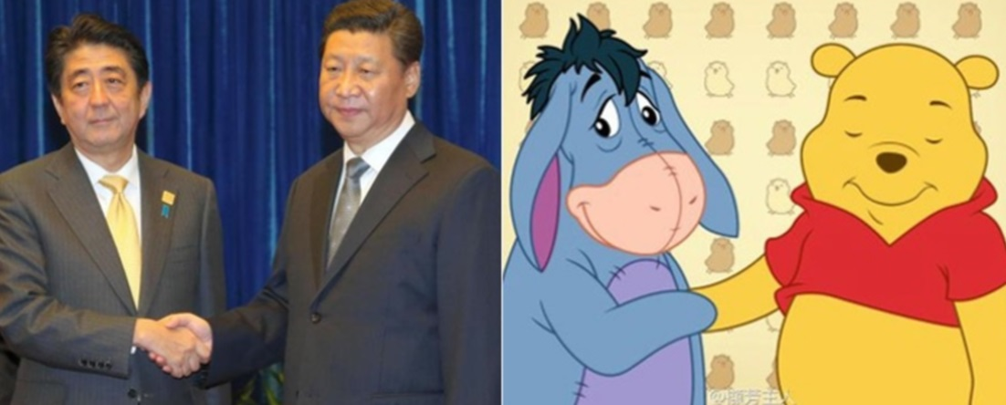 """El apretón de manos entre el primer ministro japonés Abe y el presidente de China, Xi Jinping, que se parece a """"Winnie the Pooh"""" (Foto: Shanti Phula's Blog)"""