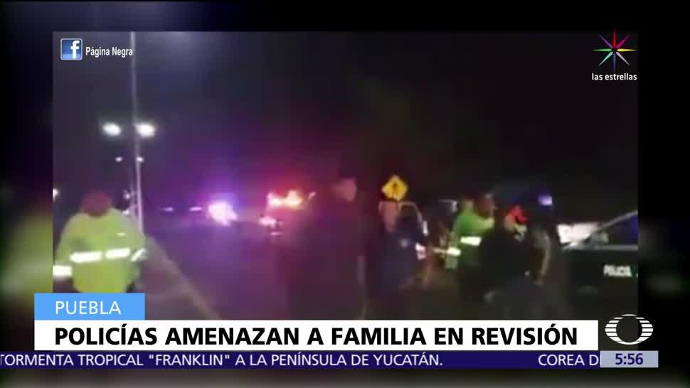 Policías, amenazan, familia, revisión