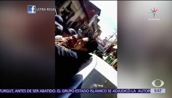 Policías, detienen, violencia, vendedor