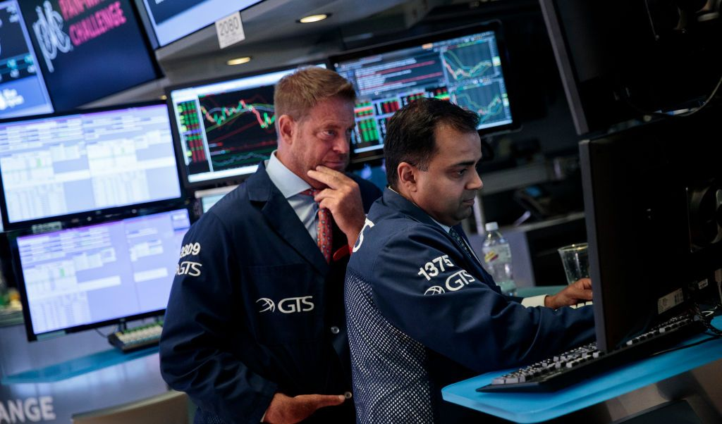 Wall Street con ganancias y el Dow Jones logra un record