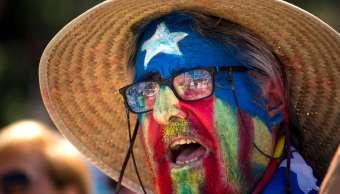 Un hombre con la bandera catalana pintada en el rostro