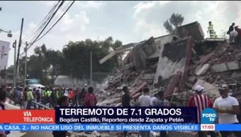 Voluntarios trabajan para sacar con vida a atrapados en Zapata y Petén